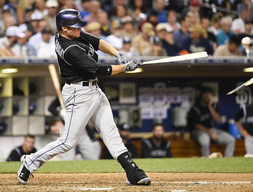 . SAN DIEGO, CA - AUGUST 12:  Josh Rutledge #14 of the Colorado Rockies breaks his bat as he grounds out during the sixth inning of a baseball game against the San Diego Padres at Petco Park August, 12, 2014 in San Diego, California.  (Photo by Denis Poroy/Getty Images)