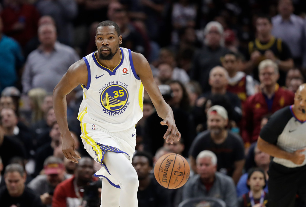 . Golden State Warriors\' Kevin Durant dribbles in the first half of Game 3 of basketball\'s NBA Finals against the Cleveland Cavaliers, Wednesday, June 6, 2018, in Cleveland. (AP Photo/Tony Dejak)
