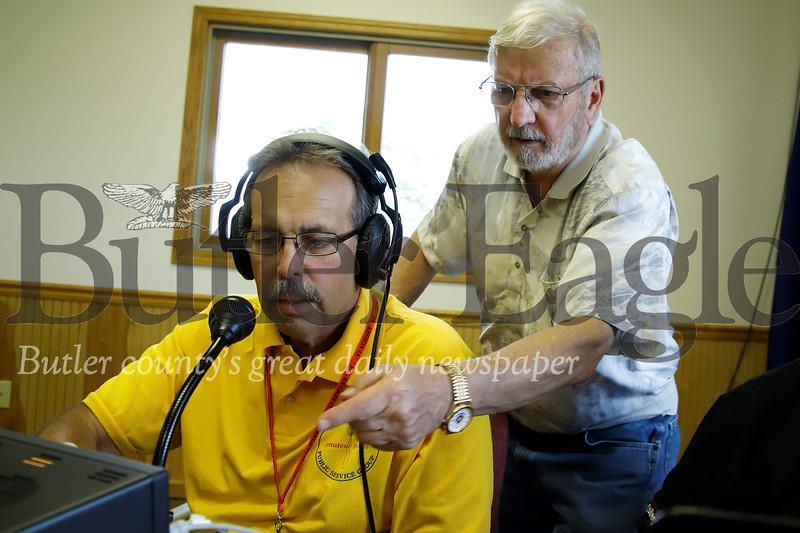 Tom McCracken suggests a signal adjustment to ham radio operator Denny Stokes. Seb Foltz/Butler Eagle