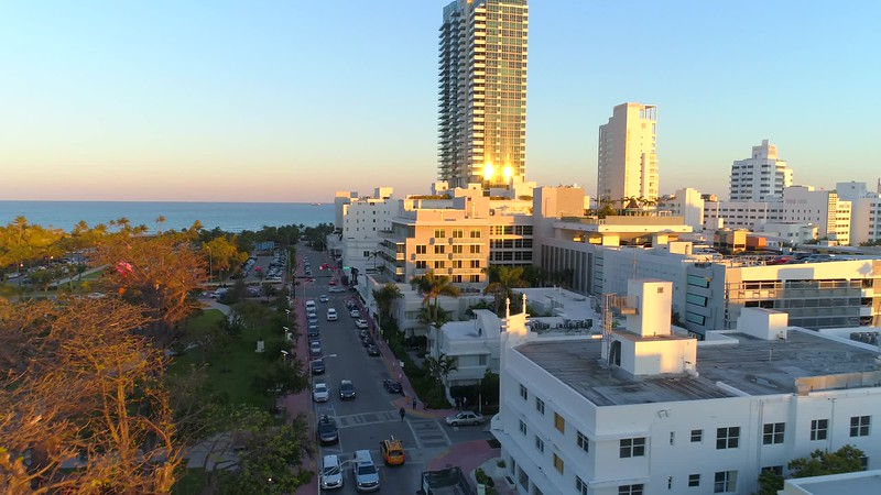 Aerial Miami Beach 21st Street passing Collins Avenue 4k