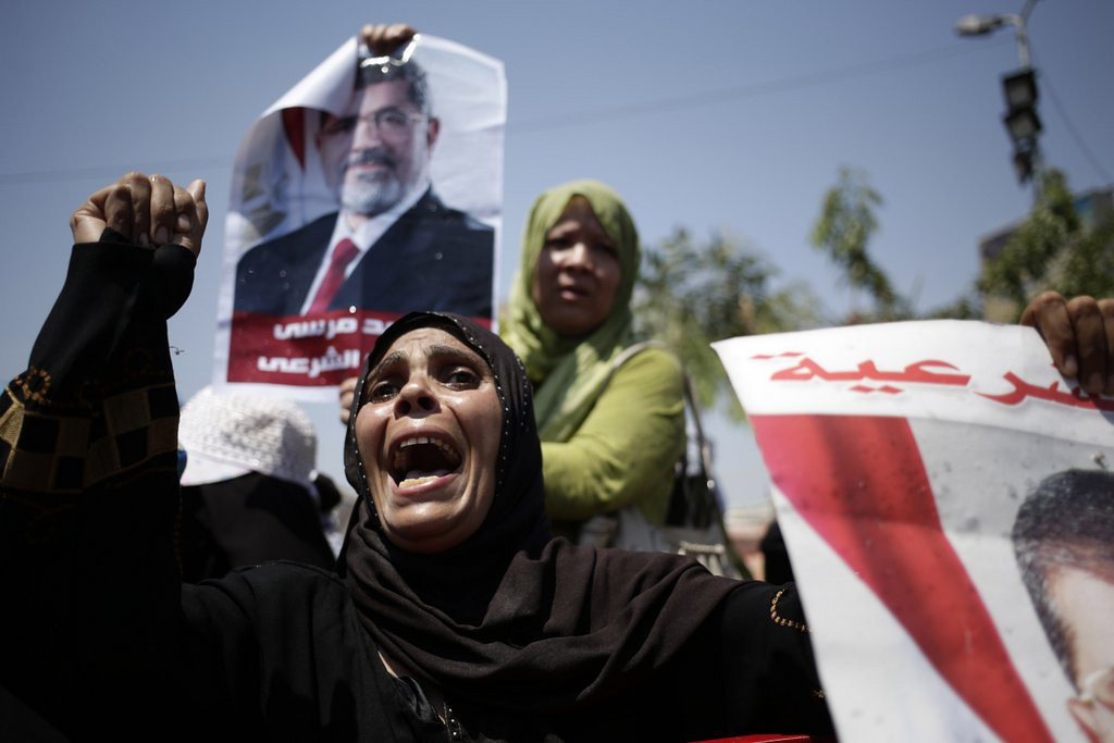 """. <p><b><a href=\'http://www.voanews.com/content/cairo-protesters-ignore-military-orders-to-disperse/1711546.html\' target=\""""_blank\""""> 8. Egypt </a></b> <p>Things will calm down after Morsi joins Mubarak in presidential prison suite. (unranked) <p> --------------------------------------------   (AP Photo/Hassan Ammar)"""