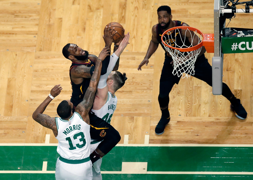 . Cleveland Cavaliers forward LeBron James, upper left, drives against Boston Celtics forward Marcus Morris (13) and center Aron Baynes during the first half in Game 7 of the NBA basketball Eastern Conference finals, Sunday, May 27, 2018, in Boston. (AP Photo/Charles Krupa)