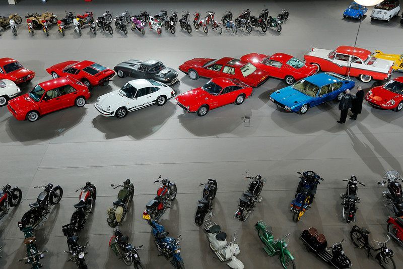 . Visitors walk past vintage and classic cars displayed by Bonhams auction house, during an exhibition in Paris, at the Grand Palais in Paris, Wednesday, Feb. 6, 2013. (AP Photo/Jacques Brinon)