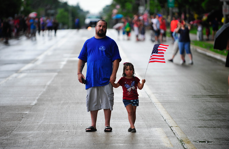 Terry Madison, of Burbank, and his daughter Emma, 5, watch as the Mokena Fire Department raise an American flag in honor of PFC Aaron Toppen. Saturday, June 21st, 2014, in Mokena. | Gary Middendorf/for Sun-Times Media