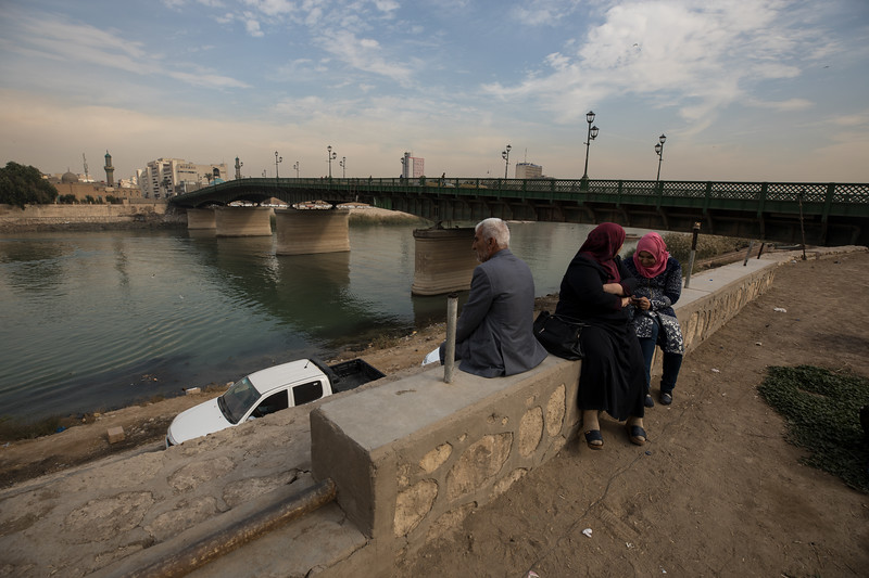 An Iraqi family resting on the banks of the Tigris River, Baghdad.