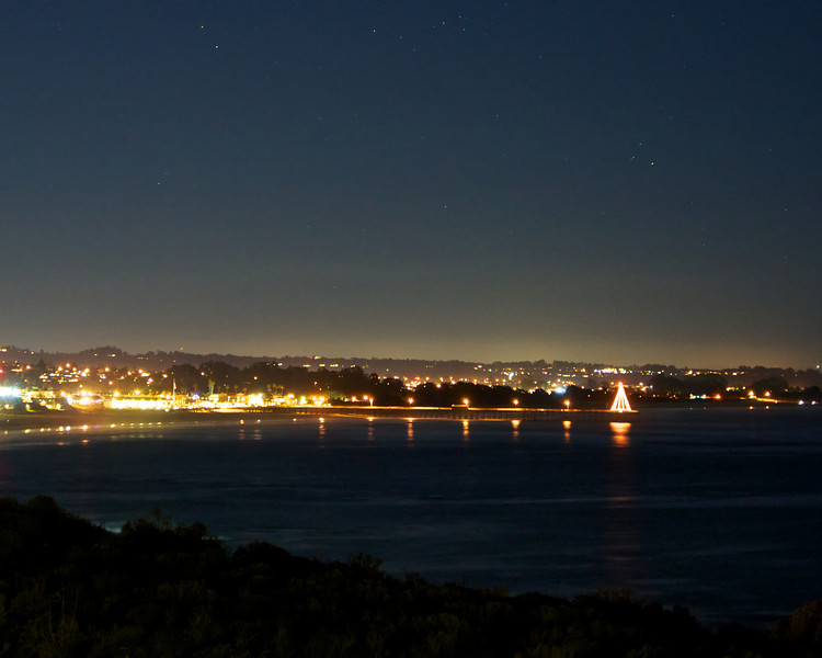 Evening shot looking onto the Pismo Beach Pier from Sheltered Cove. 
