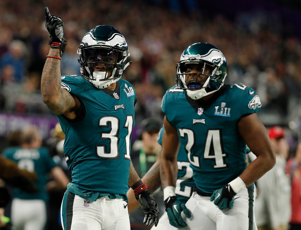 . Philadelphia Eagles cornerback Jalen Mills (31) celebrates with defensive back Corey Graham (24), after breaking up a pass intended for New England Patriots tight end Rob Gronkowski, during the first half of the NFL Super Bowl 52 football game, Sunday, Feb. 4, 2018, in Minneapolis. (AP Photo/Charlie Neibergall)