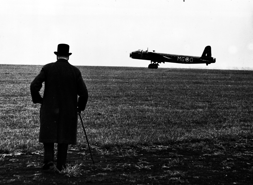 . Britain\'s Prime Minister Winston Churchill watches a Stirling bomber taxi-ing across an airfield during a visit to a Bomber Command aerodrome in England, in June 1941. (AP Photo/British Official Photo)