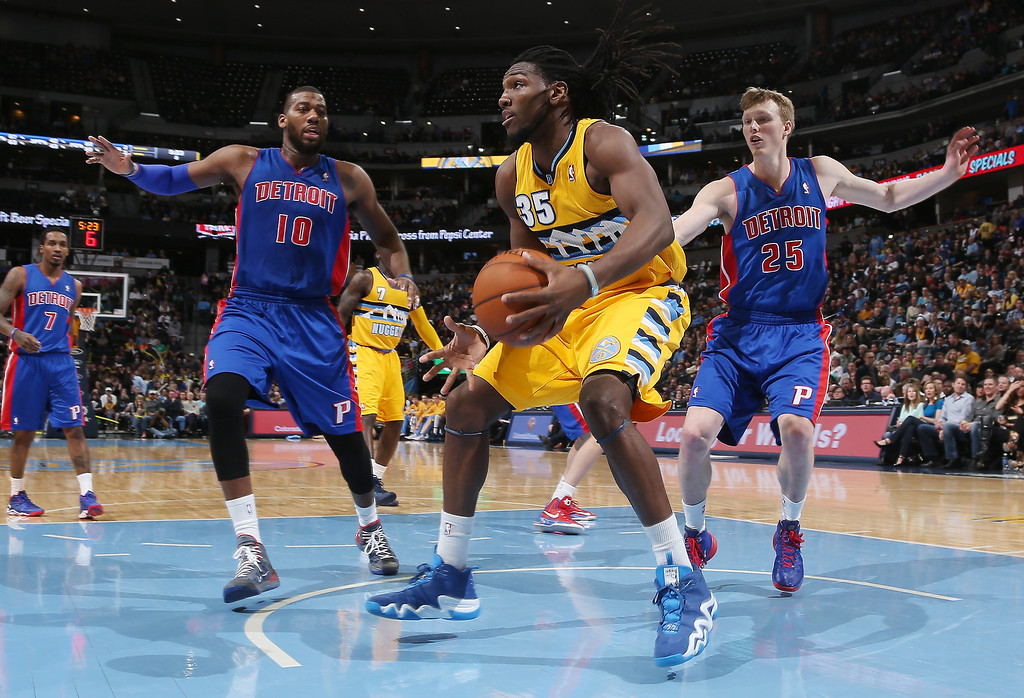 . Denver Nuggets forward Kenneth Faried, center, pulls in loose ball under the net as Detroit Pistons center Greg Monroe, left, and forward Kyle Singler cover in the third quarter of the Nuggets\' 118-109 victory in an NBA basketball game in Denver on Wednesday, March 19, 2014. (AP Photo/David Zalubowski)