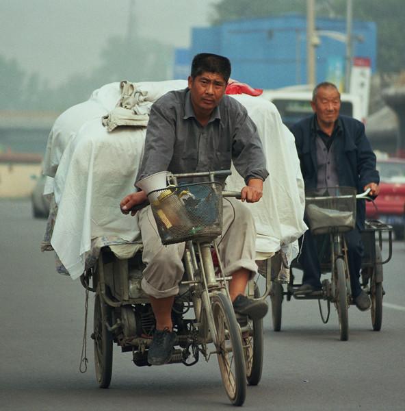 2004 October Beijing citizen peddling hard.jpg