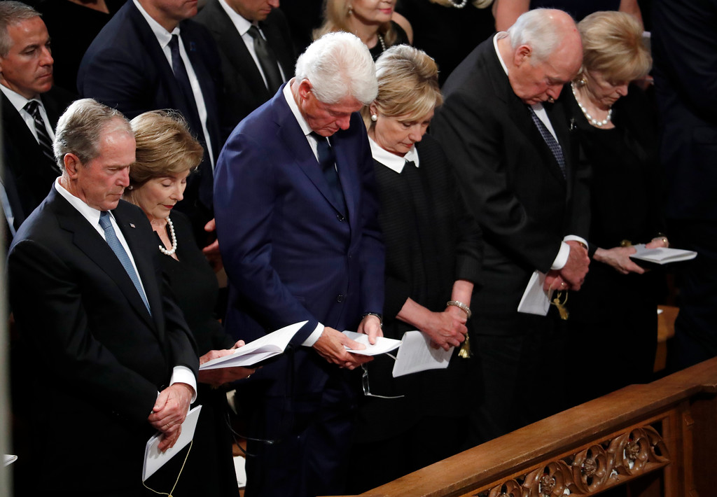 . From left, former President George W. Bush, former first lady Laura Bush, former President Bill Clinton, former Secretary of State Hillary Clinton, former Vice President Dick Cheney and his wife Lynne bow their heads in prayer at a memorial service for Sen. John McCain, R-Ariz., at Washington National Cathedral in Washington, Saturday, Sept. 1, 2018. McCain died Aug. 25, from brain cancer at age 81. (AP Photo/Pablo Martinez Monsivais)