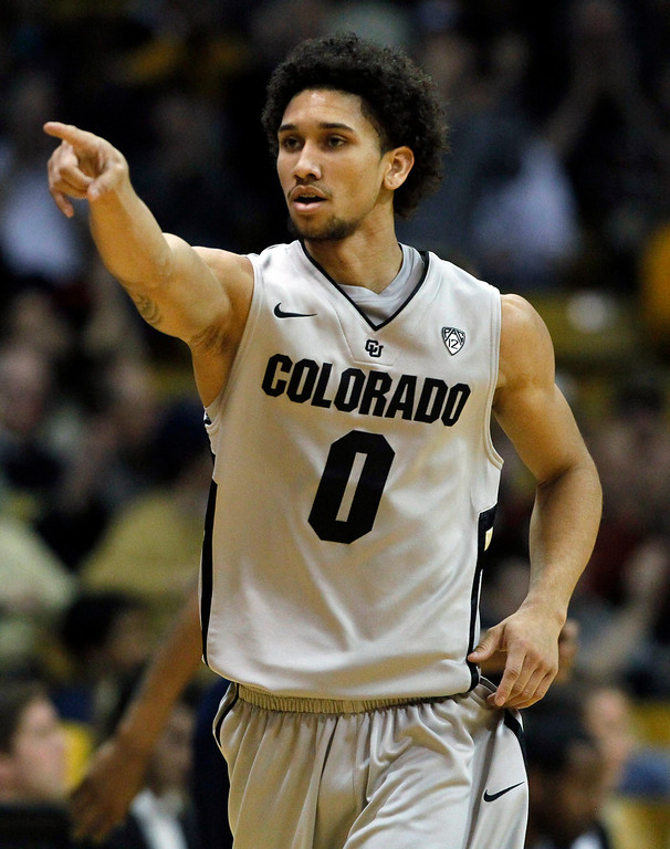 . Colorado guard Askia Booker celebrates after hitting a three-point basket against California in the first half of an NCAA basketball game in Boulder, Colo., Sunday, Jan. 27, 2013. (AP Photo/David Zalubowski)