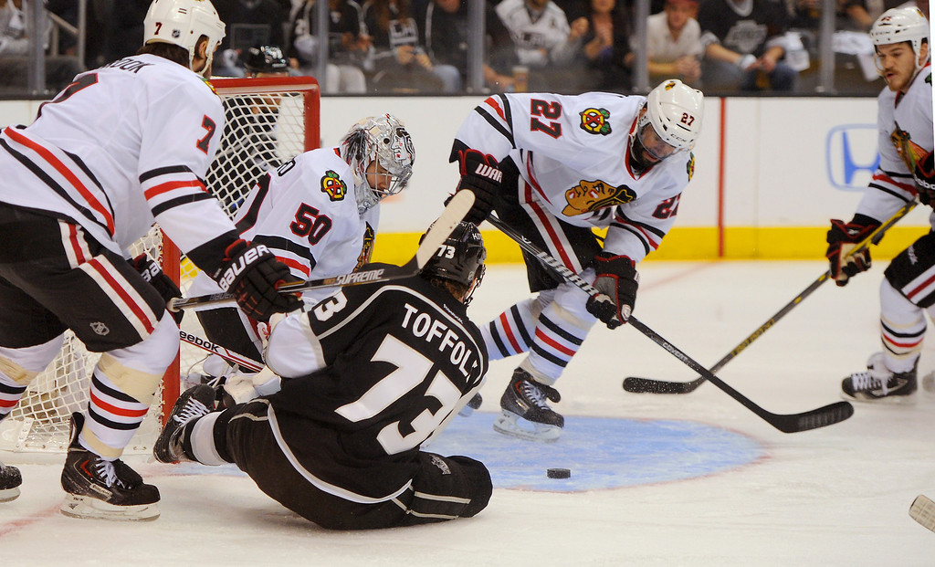 . The Kings\' Tyler Toffoli is knocked down and can\'t score against the Blackhawks\' goalie Corey Crawford during game six of the Western Conference Finals, Friday, May 30, 2014, at Staples Center. (Photo by Michael Owen Baker/Los Angeles Daily News)