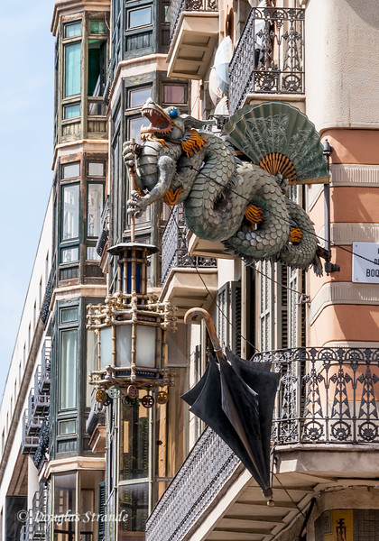 Barcelona: Umbrella House on Las Ramblas.  The dragon symbolizes power over water, rain and floods.