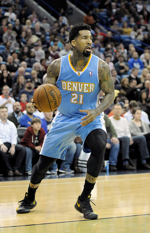 . Denver Nuggets forward Wilson Chandler grabs a loose ball in the second half of an NBA basketball game against the New Orleans Pelicans in New Orleans, Friday, Dec. 27, 2013. New Orleans won 105-89. (AP Photo/Stacy Revere)