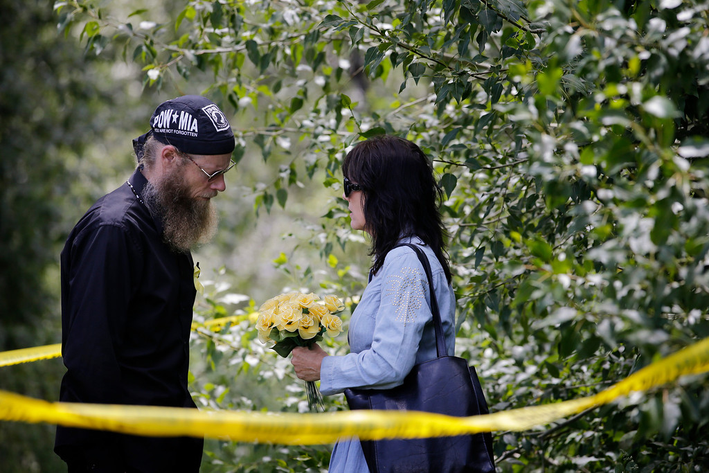 """. Bob Bergdahl, left, and wife, Jani, the parents of captive U.S. Army Sgt. Bowe Bergdahl, talk at the \""""Bring Bowe Back\"""" celebration held to honor Sgt. Bergdahl in Hailey, Idaho, Saturday, June 22, 2013. The father and mother of the only known U.S. prisoner of war plan to speak on Saturday afternoon to a big crowd in their central Idaho hometown just days after his Taliban captors announced they want to exchange him for prisoners being held at Guantanamo Bay. (AP Photo/Jae C. Hong)"""