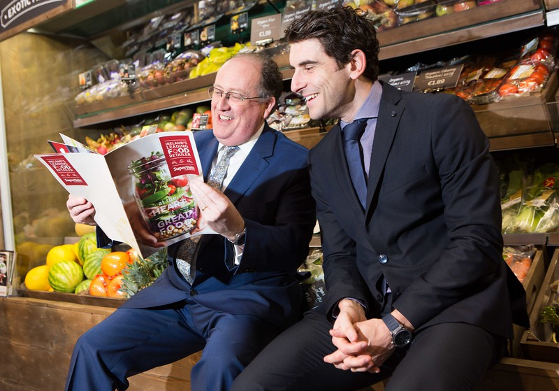 DKANE 22/02/2016 REPRO FREE A WINNING PERFORMANCE SUPERVALU REACHES NEW MILESTONE WITH RECORD SALES OF €2.6 BILLION IN 2015. Dublin GAA Star Bernard Brogan and Martin Kelleher, Managing Director SuperValu at the SuperValu National Conference in Killarney, where the brand announced sales of €2.6 billion in 2015, representing a new milestone for SuperValu and underlining its position as Ireland's most popular grocery retailer with 25% market share. Building on this strong performance, SuperValu plans to invest €28 million in 2016, opening five new stores and adding 350 jobs to the SuperValu network.   250 small Irish food producers have secured deals with SuperValu through Food Academy, the joint mentoring programme with Bord Bia and the Local Enterprise Office. Sales of Food Academy products exceeded targets by hitting an impressive €13 million in 2015. PIC DARRAGH KANE