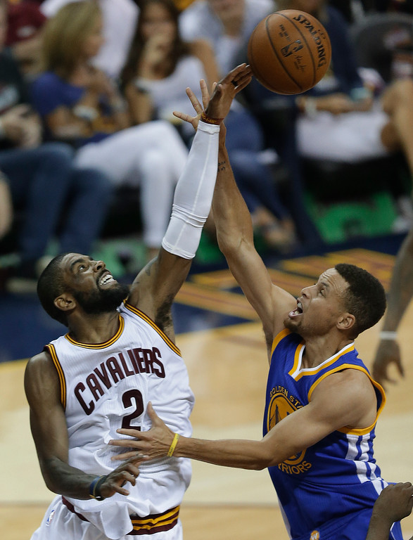 . Cleveland Cavaliers guard Kyrie Irving (2) blocks a shot by Golden State Warriors guard Stephen Curry (30) during the first half of Game 4 of basketball\'s NBA Finals in Cleveland, Friday, June 10, 2016. (AP Photo/Tony Dejak)