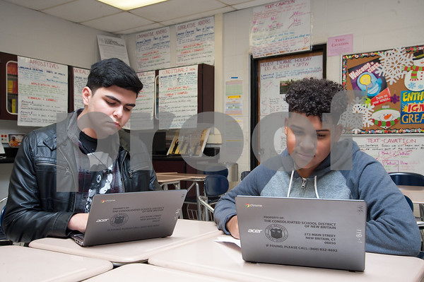01/18/18 Wesley Bunnell | Staff 10th grade student at New Britain High School Angel Diaz works alongside 9th grade student Erik Pacheco on Thursday afternoon. The two are part of a group of students who have relocated to New Britain from Puerto Rico following the devastating Hurricane Maria.