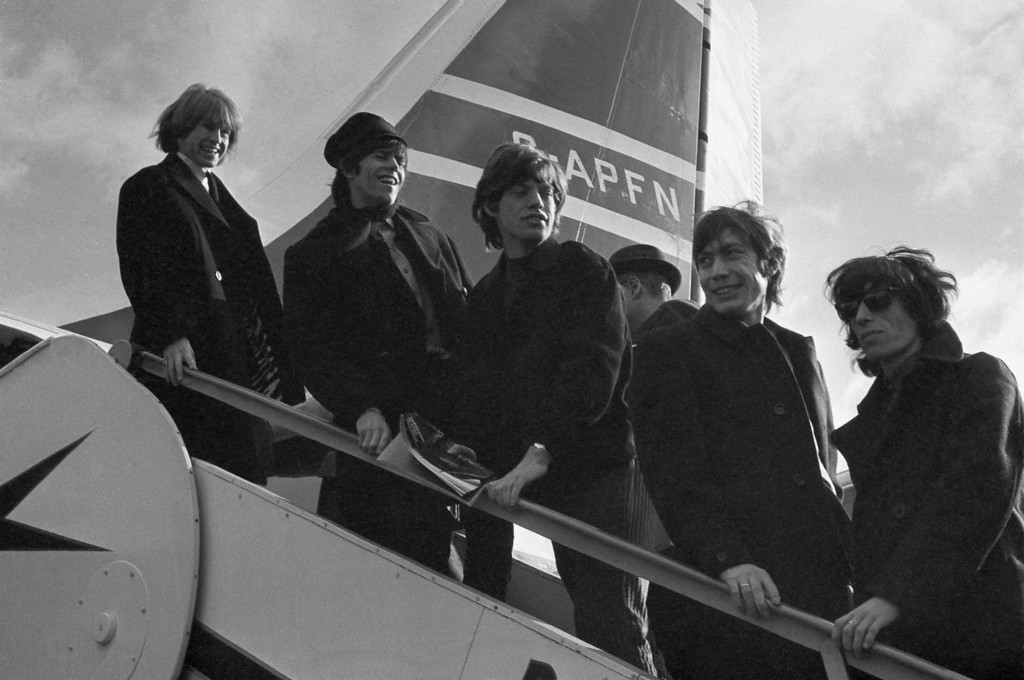 . The Rolling Stones \'pop\' group from left Brian Jones, Keith Richards, Mick Jagger, Charlie Watts and Bill Wyman, board a New York bound Airliner at London Airport  October 23, 1964. They were off on a U.S. Tour. (AP Photo/Victor Boyton)