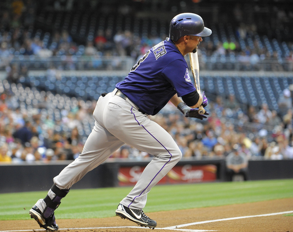 . Michael Cuddyer #3 of the Colorado Rockies hits a single during the first inning of a baseball game against the San Diego Padres at Petco Park on July 10, 2013 in San Diego, California.  (Photo by Denis Poroy/Getty Images)