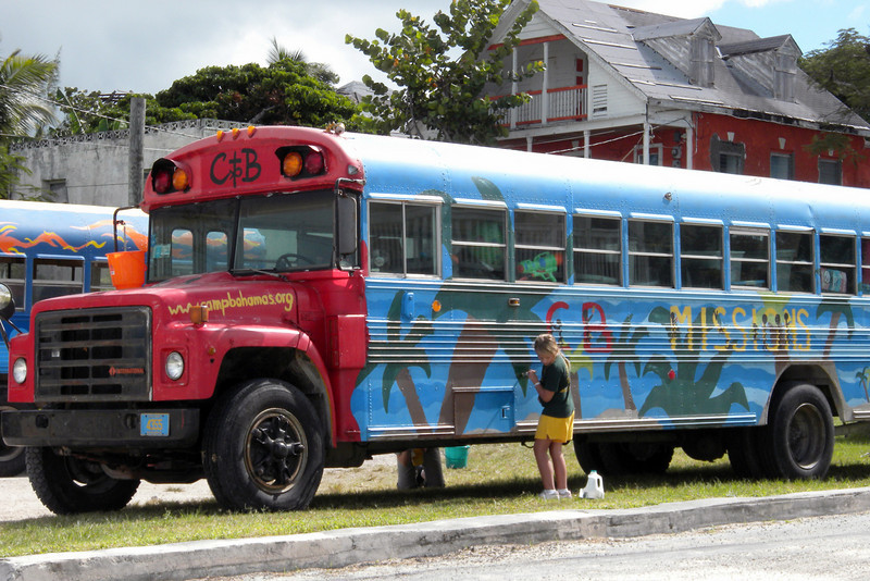Students painting church bus