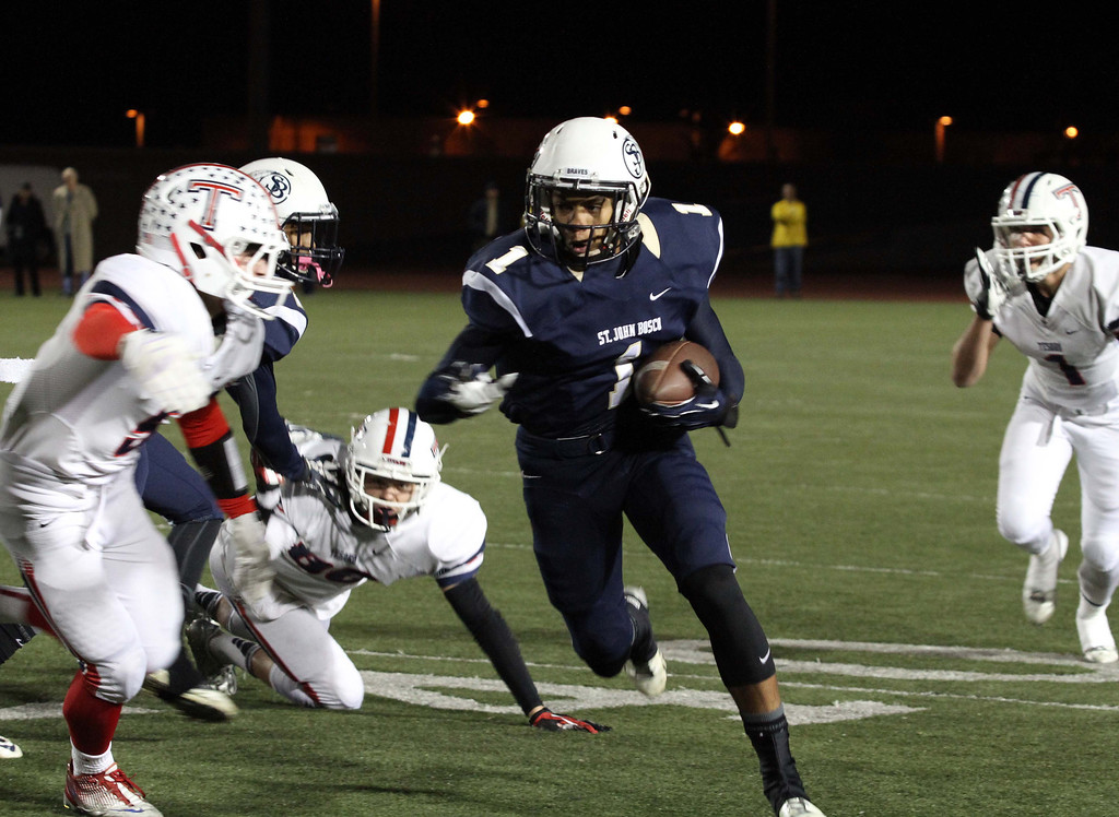 . November 22, 2013-Photo by Tracey Roman/for the Press-Telegram  St. John Boscos Shay Fields gets past Tesoro defense as the Braves take the lead early on Friday night.