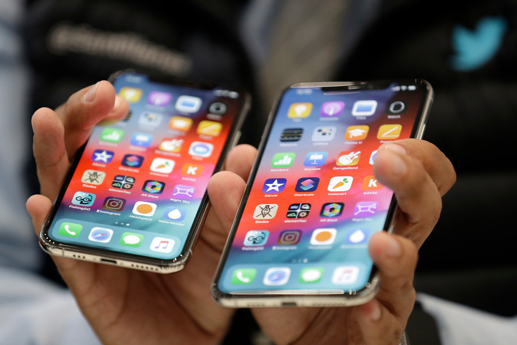 . The iPhone XS, left, and XS Max are displayed side to side during an event to announce new products at Apple headquarters Wednesday, Sept. 12, 2018, in Cupertino, Calif. (AP Photo/Marcio Jose Sanchez)