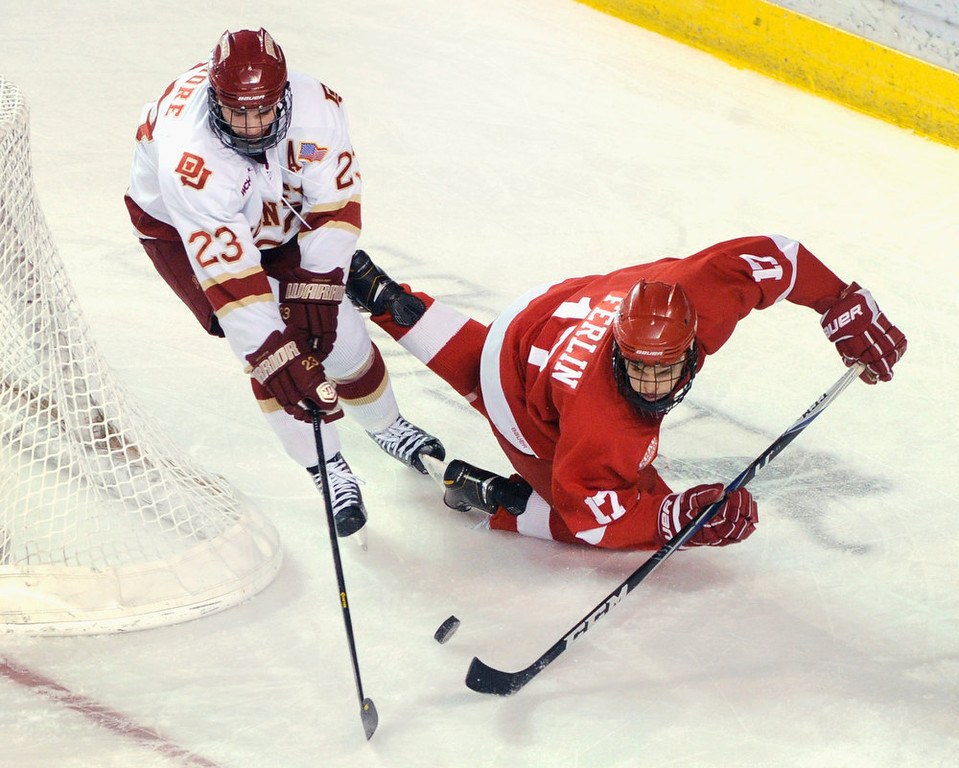 . Denver center Nick Shore (23) intercepted a wrap-around attempt by Cornell wing Brian Ferlin (17) in the third period. The University of Denver hockey team defeated Cornell 2-1 at Magness Arena Saturday night, January 5, 2013. Karl Gehring/The Denver Post
