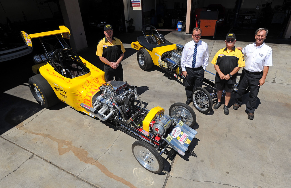 . The Gruzen Racing team is ready for this weekends Bellflower Car Show as they gather with two of their race cars at Leo and Sons Garage in Bellflower, CA on Wednesday, September 4, 2013. From left, Brad Terry, Donald Henderson, Joel Gruzen and Dave Gruzen. (Photo by Scott Varley, PRESS-TELEGRAM)