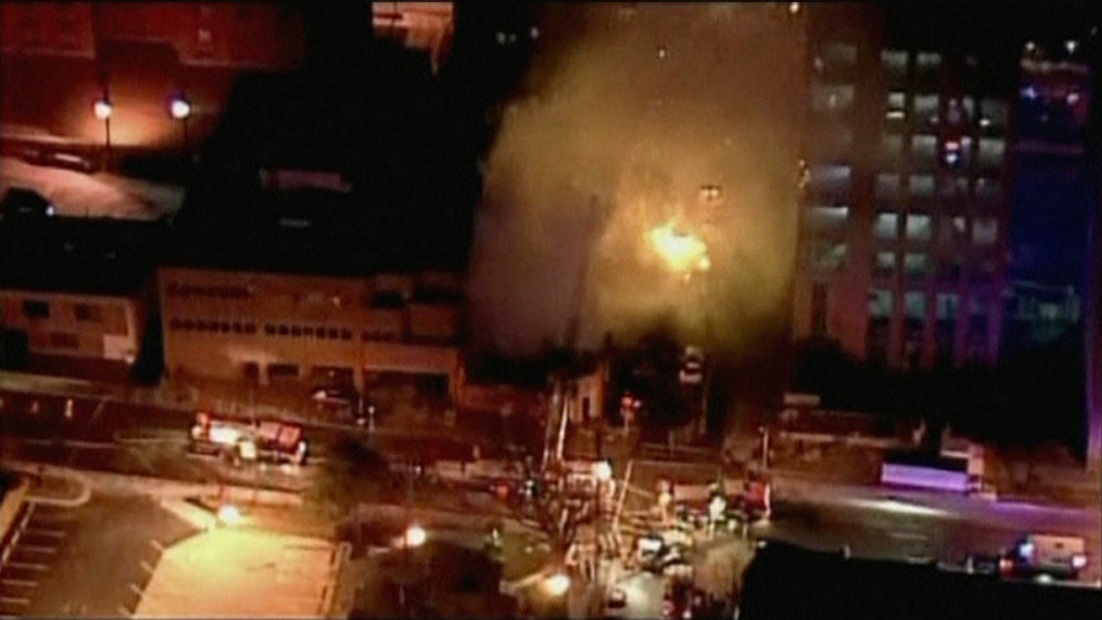 . A still image taken from a KHSB-TV video footage shows aerial of the building with flames at Kansas City, Missouri February 19, 2013. A fire triggered by a natural gas explosion that appeared to have originated underground engulfed a restaurant in Kansas City, Missouri, on Tuesday, injuring more than a dozen people, authorities and witnesses said.  REUTERS/KHSB-TV