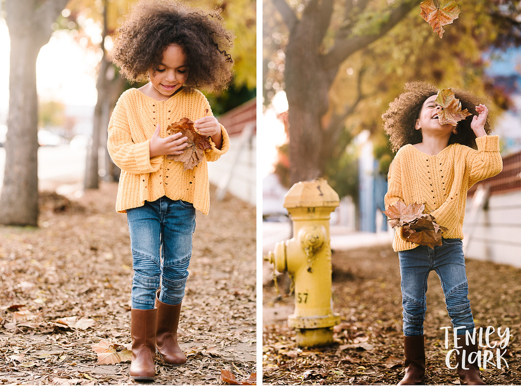 Little girl playing with fall leaves in San Jose by Tenley Clark Photography.