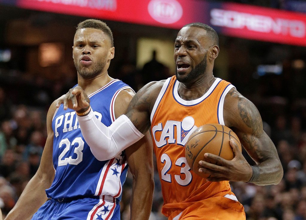 . Cleveland Cavaliers\' LeBron James, right, drives to the basket against Philadelphia 76ers\' Justin Anderson in the first half of an NBA basketball game, Friday, March 31, 2017, in Cleveland. (AP Photo/Tony Dejak)