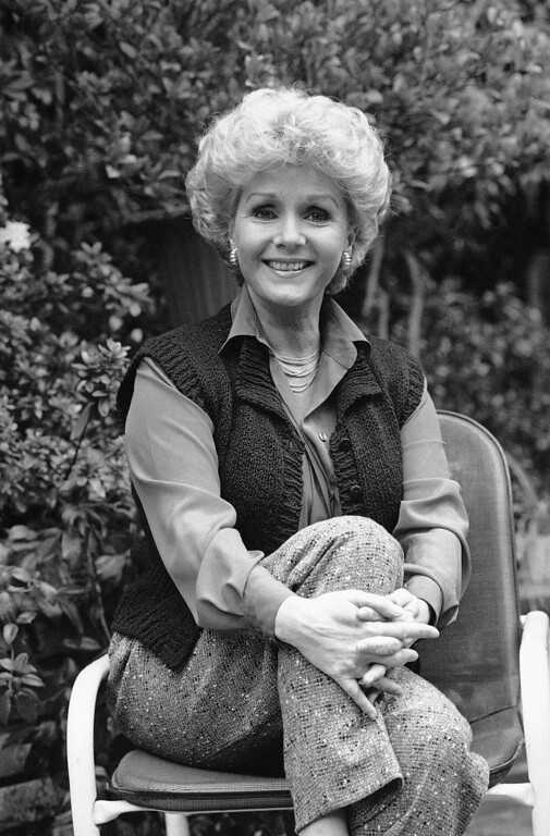 . Debbie Reynolds smiles at her home, April 1986. (AP Photo)