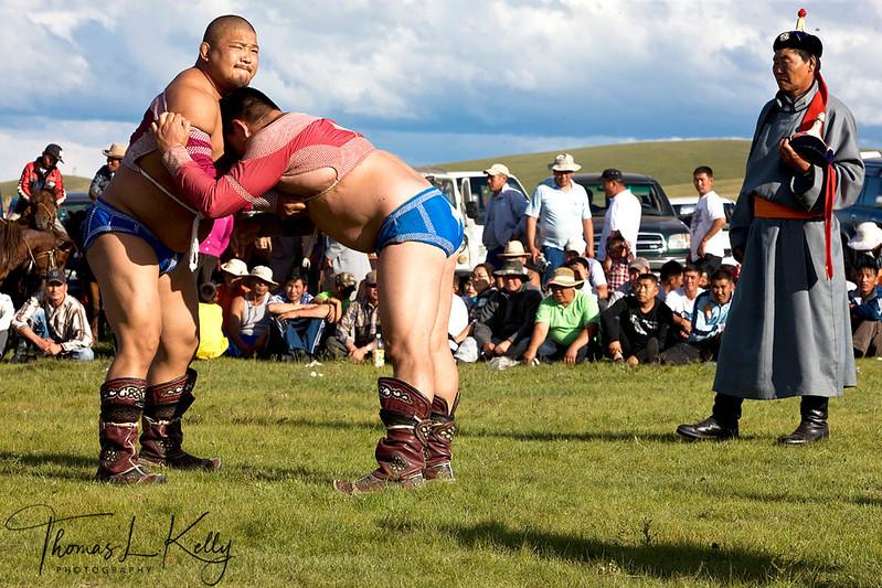 Wrestling match during Annual Naadam festival. Mongolia.