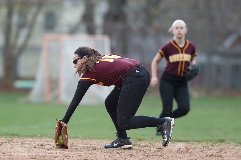 Sheehan's Sara Pisanelli (16) fields a hit from Lyman Hall's Sami Forster (2) Monday at Lyman Hall High School in Wallingford  Apr. 27, 2015 | Justin Weekes / For the Record-Journal