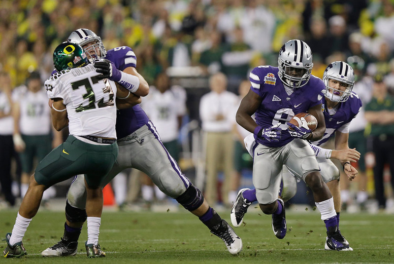 . Angelo Pease #8 of the Kansas State Wildcats runs the ball against the Oregon Ducks during the Tostitos Fiesta Bowl at University of Phoenix Stadium on January 3, 2013 in Glendale, Arizona.  (Photo by Ezra Shaw/Getty Images)