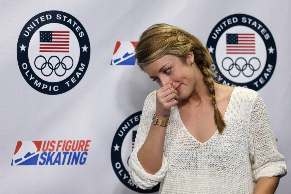 . Ashley Wagner steps off the podium after facing reporters at a news conference at the U.S. Figure Skating Championships Sunday, Jan. 12, 2014 in Boston. Two-time U.S. champion Ashley Wagner made the Olympic team Sunday despite finishing a distant fourth at the national championships. (AP Photo/Steven Senne)
