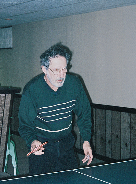 Larry Lebin, playing ping pong in our basement, Dec 31 1998.