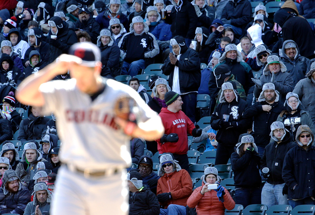 . Fans watch the seventh inning of a baseball game between the Cleveland Indians and the Chicago White Sox, Saturday, April 9, 2016, in Chicago. (AP Photo/Nam Y. Huh)