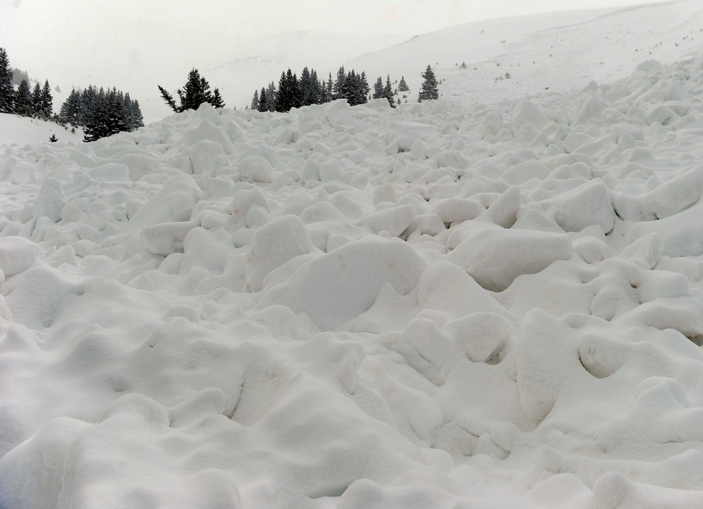 . LOVELAND PASS, CO. - APRIL 20:  A ten-foot slab of snow broke free and buried six backcountry thick snowboarders in an avalanche in Sheep Creek Bowl below Loveland Pass Saturday, April 20, 2013.  One survived but the others five died at the scene. Photo By Karl Gehring/The Denver Post