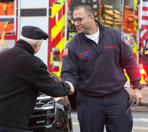 01/31/20 Wesley Bunnell | StaffrrA fire occurred at 40 Chestnut St on Friday afternoon January 31, 2020 requiring one person to be taken by ambulance for smoke inhalation. A resident of the building shakes hands with Fire Chief Raul Ortiz.