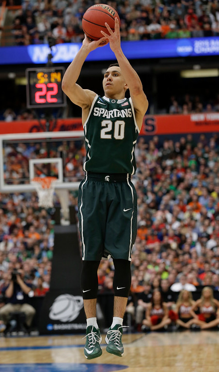 . Michigan State\'s Travis Trice (20) shoots the ball during the second half of a regional final against Louisville in the NCAA men\'s college basketball tournament Sunday, March 29, 2015, in Syracuse, N.Y. (AP Photo/Seth Wenig)