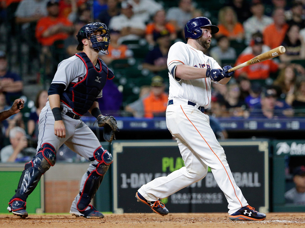 . Houston Astros catcher Brian McCann (16) watches his two-run home run ball in front of Cleveland Indians catcher Yan Gomes during the seventh inning of a baseball game, Sunday, May 20, 2018, in Houston. (AP Photo/Michael Wyke)