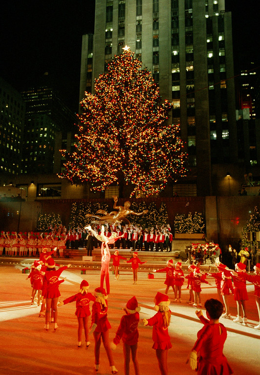 . Festivities at the annual lighting of the Rockefeller Center Christmas tree are shown on the ice skating rink in New York, Dec. 2, 1992.  (AP Photo/Ed Bailey)