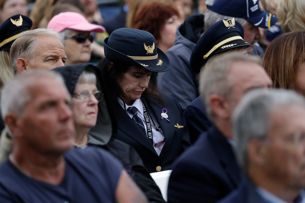 . Audience members attend and listen to the September 11th Flight 93 Memorial Service, Tuesday, Sept. 11, 2018, in Shanksville, Pa. President Donald Trump is marking 17 years since the worst terrorist attack on U.S. soil by visiting the Pennsylvania field that became a Sept. 11 memorial.  (AP Photo/Evan Vucci)