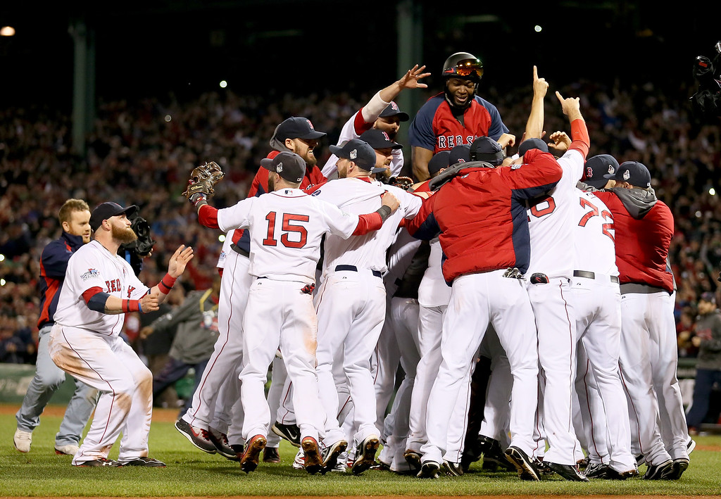 . The Boston Red Sox celebrate after defeating the St. Louis Cardinals in Game Six of the 2013 World Series at Fenway Park on October 30, 2013 in Boston, Massachusetts. The Boston Red Sox defeated the St. Louis Cardinals 6-1.  (Photo by Rob Carr/Getty Images)