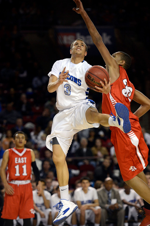. DENVER, CO. - FEBRUARY 09: Evan Motlong (3) of Highlands Ranch drives to the basket on Tyre Robinson (32) Highlands Ranch February 9, 2012 at Magness Arena.  East defeated Highlands Ranch 73 - 54. (Photo By John Leyba/The Denver Post)