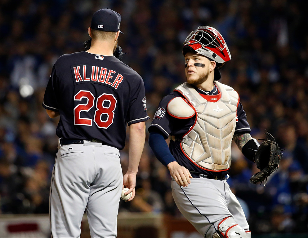 . Cleveland Indians starting pitcher Corey Kluber (28) talks to catcher Roberto Perez during the first inning of Game 4 of the Major League Baseball World Series against the Chicago Cubs, Saturday, Oct. 29, 2016, in Chicago. (AP Photo/Nam Y. Huh)