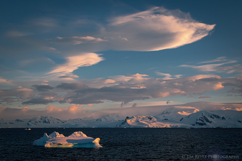 Clouds and icebergs at sunset - Gerloche Strait, Antarctica.